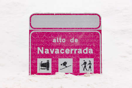 Signal road information post. Winter time. Covered by snow Stock Photo