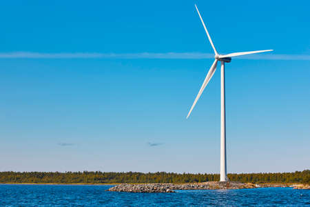Wind turbine in the baltic sea. Renewable green energy. Finland