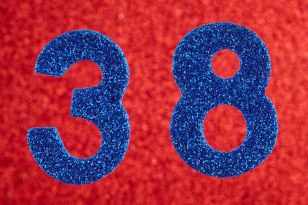 Number thirty-eight blue color over a red background. Anniversary. Horizontal