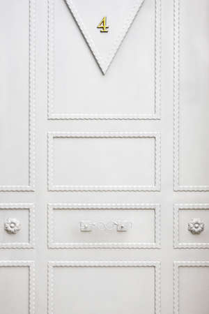White metallic classic door detail. Home entrance background. Vertical