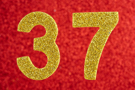 Number thirty-seven yellow color over a red background. Anniversary. Horizontal