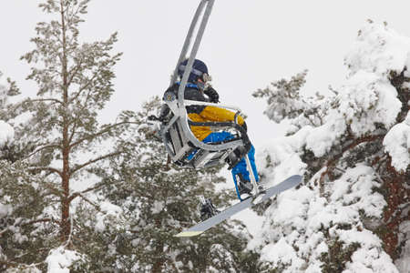 Ski lift and slope on a snow landscape. Winter sport. Horizontal Standard-Bild