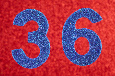 Number thirty-six blue color over a red background. Anniversary. Horizontal