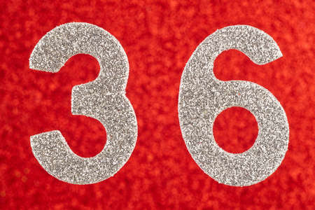 Number thirty-six silver color over a red background. Anniversary. Horizontal Stok Fotoğraf