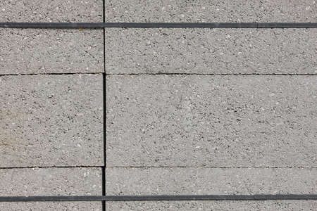Stacked concrete blocks. Construction material. Brickwork. Architecture. Horizontal