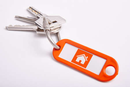 Key ring with keys over white background.