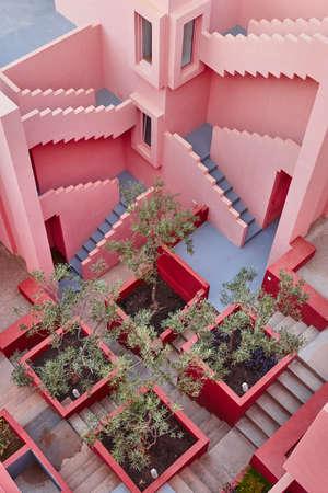 Geometric building stairs. The red wall, La manzanera. Calpe, Spain Stock Photo