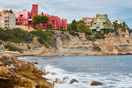 Spanish mediterranean coastline in Alicante. La manzanera. Red wall. Calpe Stock Photo