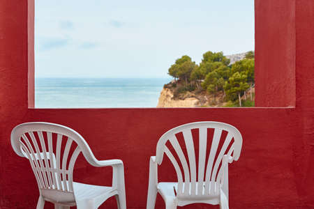 Mediterranean coastline landscape viewed from a red open terrace. Relaxing Stock Photo