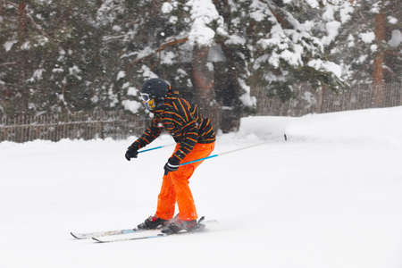 Skier under the snow. Winter sport. Ski slope. Horizontal
