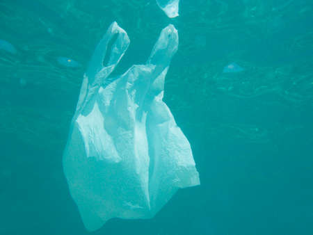 Plastic bag floating into the sea. Polluted environmental. Recycle garbage
