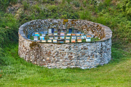 Beehives. Traditional stone wall structure against bears. Muniellos, Asturias in Spain