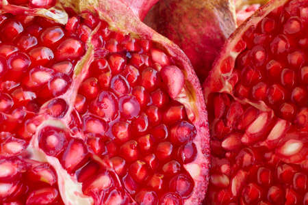 Pomegranate fruit seeds macro detail. Healthy food. Horizontal Stock Photo