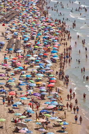 Mediterranean coastline in Spain. Calpe beach. Summer crowd. Alicante seascape