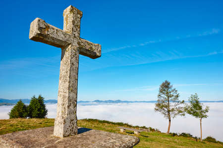 Antique stone cross sanctuary in Asturias, Spain. El Acebo viewpoint