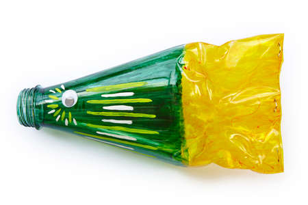 Plastic bottle recycled in a fish figure. Reuse garbage. Isolated Stock Photo