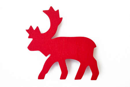 Red reindeer wooden christmas figure isolated on white. Winter season