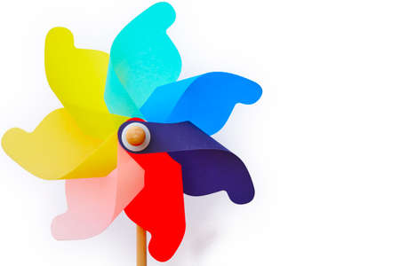 Multicolored pinwheel windmill toy isolated on white. Summer and childhood Stock Photo