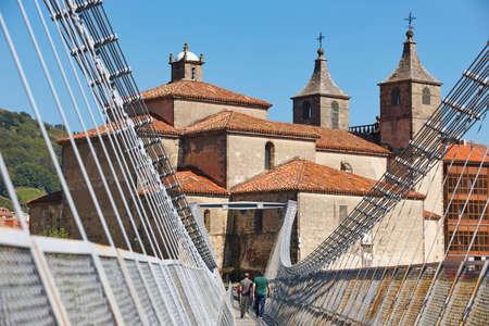 Baroque church with modern bridge. Cangas del Narcea, Asturias. Spain