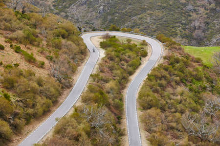 Motorcycle on a curved asphalt mountain road. Travel background Stock Photo
