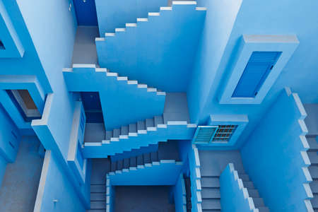 Geometric building design. The red wall, La manzanera. Calpe, Spain Stock Photo