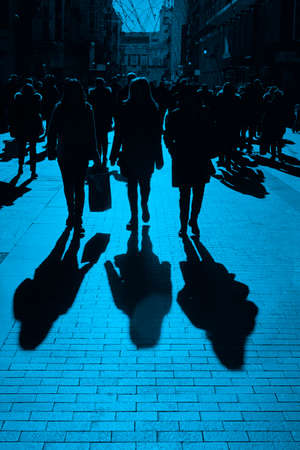 People on the street. Urban crowd in blue tone. Vertical 免版税图像