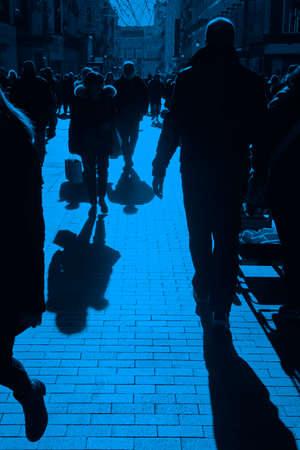 People on the street. Urban crowd in blue tone. Vertical 版權商用圖片
