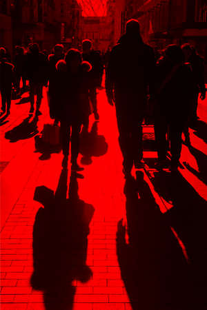 People on the street. Urban crowd in red tone. Vertical