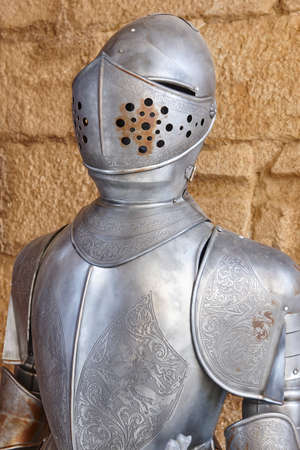 Antique medieval knight armor protection with helmet. Military defense. Vertical