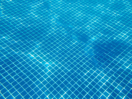 Water reflections on a swimming pool. Underwater photography. Summertime. Horizontal