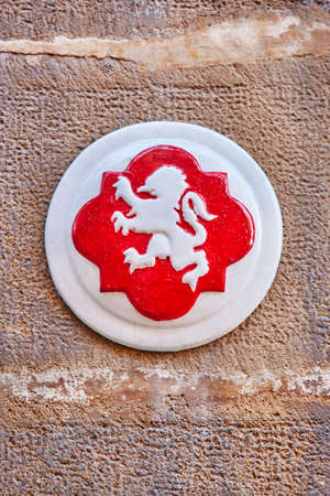 Antique Ubeda city symbol. White lion and red background. Spain Stock Photo