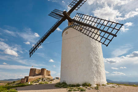 Traditional antique windmills and castle in Spain. Consuegra, Toledo