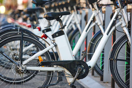 Charging urban electric battery bikes in the city. Transport Reklamní fotografie