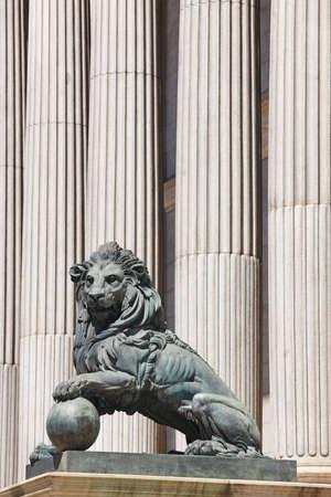 Parliament facade columns and lion in Madrid, Spain. Congreso diputados