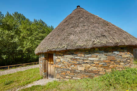 Traditional spanish construction made with stones and conical roof. Palloza