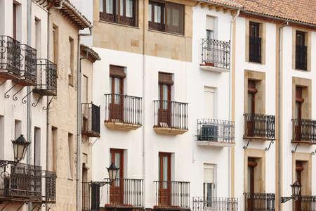Traditional building facades with balconies in Baeza, Jaen. Spain