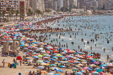 Mediterranean coastline in Spain. Calpe beach. Summer crowd. Alicante seascape