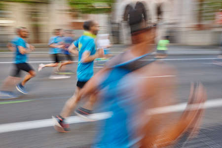 Marathon runner in motion on the street. Healthy lifestyle. Exercise