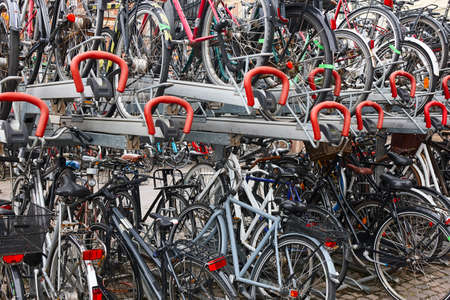 Downtown urban parking lot for bikes in Copenhague. Ecology transport