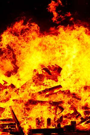 Fire flames on a bonfire. Fireman emergency. Danger combustion, emission 版權商用圖片
