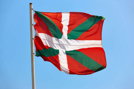 Euskadi flag waving under blue sky background. Basque country, Spain