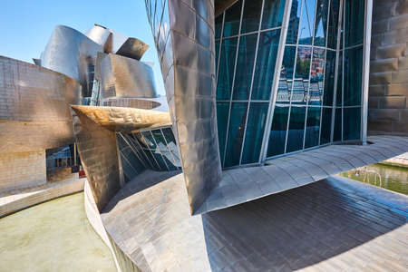 Bilbao downtown Guggenheim museum titanium metallic facade. Cultural tourism Spain 免版税图像