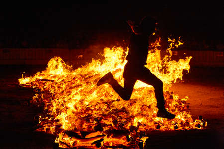 Summer solstice celebration in Spain. Jumping into the fire. Horizontal