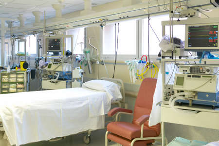 Hospital intensive care unit area with beds equipment. Health center Stock fotó