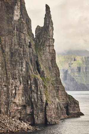 Stack in Faroe islands, Sandavagur. Trollkonufingur in Vagar island coastline.