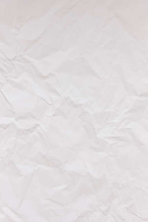White crumpled wrinkled textured paper background. Empty space