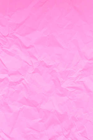 Pink crumpled wrinkled textured paper background. Empty space 写真素材