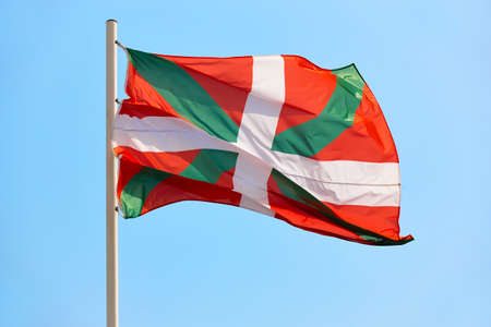 Euskadi flag waving under blue sky background. Basque country, Spain