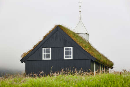 Traditional faroese church with grass roof on a foggy day. Stock fotó