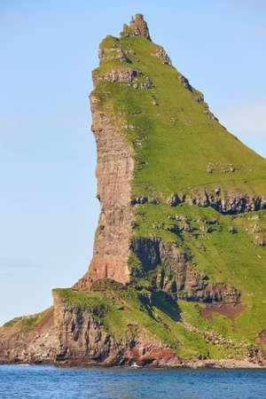 Faroe islands green coastline landscape near Vagar island. Seascape